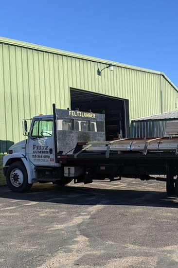 Feltz Lumber flat bed truck outside of facility